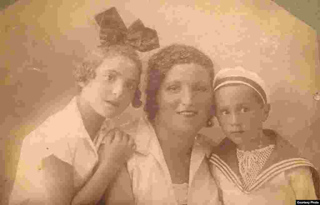 Remarkable stories lie behind seemingly ordinary family portraits. Anastasia Aslanova, a young Kyiv resident, fondly remembers her grandmother Emma (left, pictured in 1932 with her mother and brother), who ran away from home after her mother died and volunteered as a nurse in World War II. She later met her husband while working at a Russian prison camp where he had been sent as an alleged Nazi sympathizer.