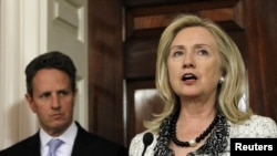 U.S. Secretary of State Hillary Clinton, flanked by Treasury Secretary Timothy Geithner, announced new U.S. steps to increase pressure on Iran in November.