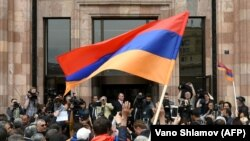 ARMENIA -- Opposition supporters shout in front of the Marriott hotel during Armenia's protest leader press conference in Yerevan, April 27, 2018