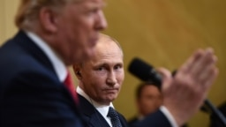 U.S. President Donald Trump (left) and Russian President Vladimir Putin talk to reporters in Helsinki on July 16.