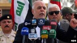 Ирак премьер-министір Хайдар әл-Абади Анбар провинциясының орталығы Рамади қаласына жақын Хаббания әскери-әуе базасында сөйлеп тұр. Ирак, 8 сәуір 2015 жыл.