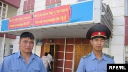 Two police officers guard a polling station in Bishkek.