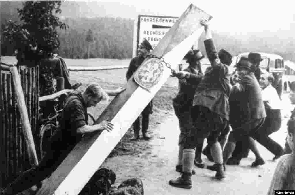Germans remove a Czechoslovak border post in September/October 1938. The Sudetenland took its name from the Sudeten mountain range that runs along the Czech-German and (after 1945) Czech-Polish border, which had a large population of ethnic Germans.