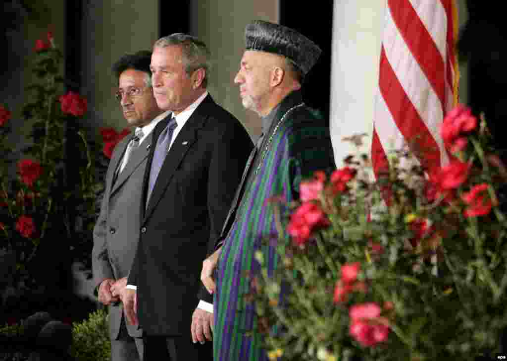 Pakistan President Pervez Musharraf (left), U.S. President George W. Bush (center), and Afghan President Hamid Karzai at the White House on September 27 (epa) - Afghan President Hamid Karzai sat down with RFE/RL in November to discuss relations between his country and Pakistan, among other things. Karzai announced that he had proposed a joint council that would bring together people from both sides of the border to discuss ways of eliminating the violence.
