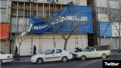 Iranian Foreign Ministry Spokesman tweeted this photo which shows a Samsung banner being pulled down in Tehran. February 14, 2020.