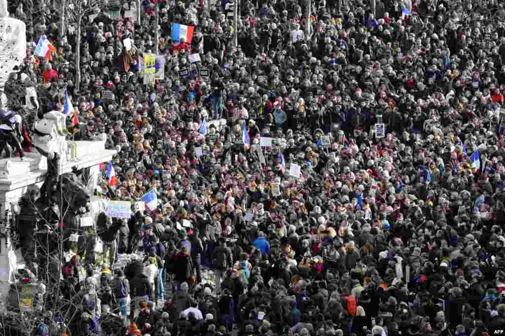 People gather on the Place de la Republique in Paris before the start of the march.