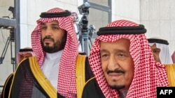 A handout picture provided by the Saudi Royal Palace on November 20, 2019 shows Saudi Arabia's King Salman bin Abdulaziz (R) with Crown Prince Mohammed bin Salman, in the capital Riyadh.