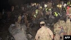 Pakistani soldiers search for victims from the wreckage of the crashed PIA passenger plane Flight PK661 at the site in the village of Saddha Batolni in the Abbottabad district of Khyber Pakhtunkhwa province on December 7.