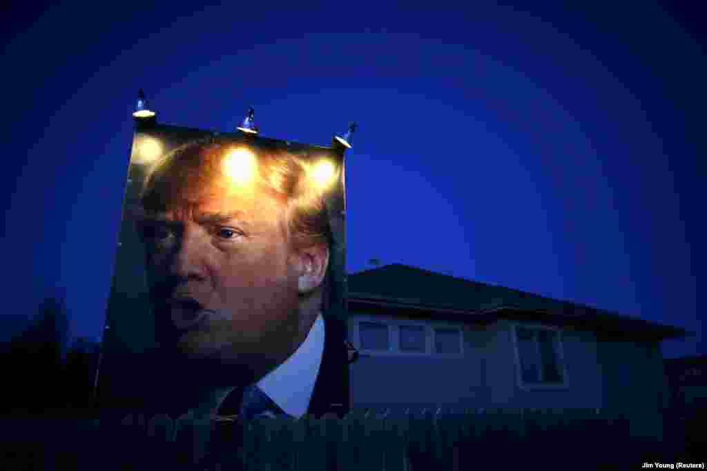 A picture of U.S. Republican presidential candidate Donald Trump hangs outside a house in West Des Moines, Iowa, on January 15. (Reuters/Jim Young)
