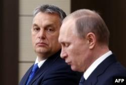 Венгерский премьер-министр Виктор Орбан в тени Владимира Путина. Москва, зима 2016 года