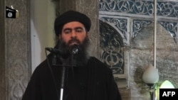 An undated video grab allegedly shows the leader of the Islamic State (IS) jihadist group, Abu Bakr al-Baghdadi at a mosque in Mosul.