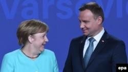 Канцлерка Німеччини Анґела Меркель та президент Польщі Анджей Дуда під час саміту НАТО у Варшаві, 2016 рік