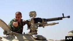 یک نیروی پیشمرگه کرد در جبهه نبرد علیه «خلافت اسلامی»