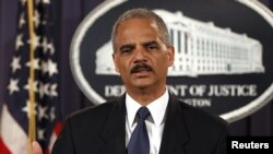 U.S. Attorney General Eric Holder announces charges of terrorism violations against 14 people for providing resources to the foreign organization Al-Shabab.