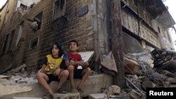 Deca u razrušenom gradu Homs, 19. septembar 2013.