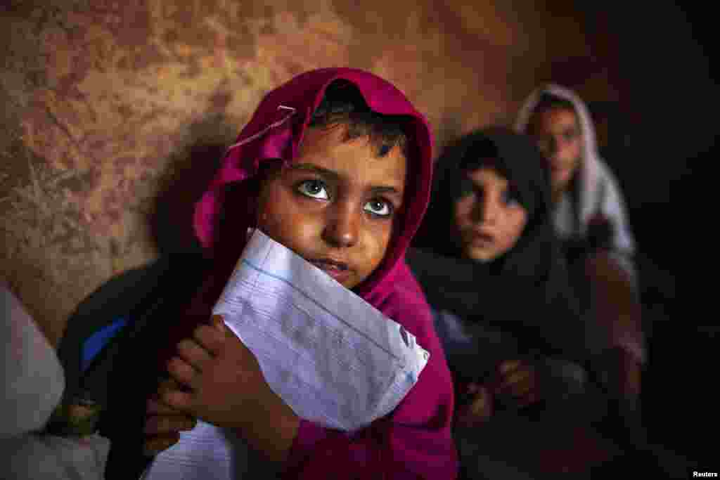 Pakistani girls attend lessons at a school in a slum on the outskirts of Islamabad. (Reuters/Zohra Bensemra)