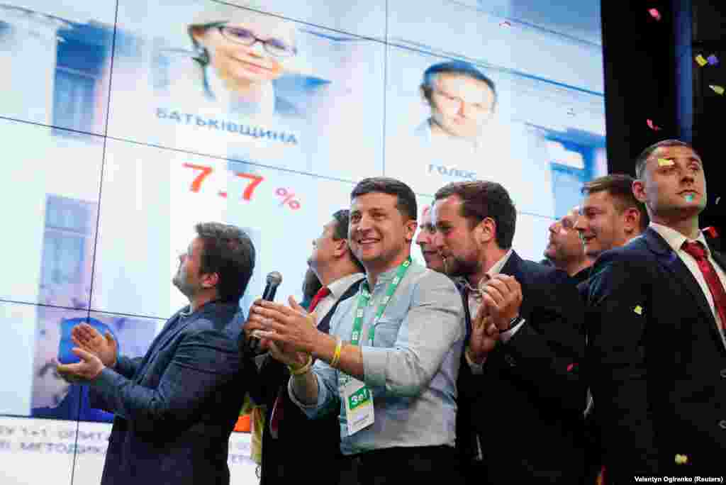 Ukrainian President Volodymyr Zelenskiy reacts at his party's headquarters in Kyiv as exit poll results are announced on July 21, 2019. (Reuters/Valentyn Ogirenko)