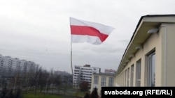 The banned Belarusian national flag flies in Vitebsk in December.