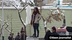 "The second ""Girl of Revolution St. who was arrested on January 29, after standing on the same electricity box that another woman stood without veil in December."