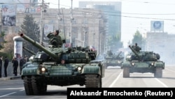 Donetsk separatist troops drive tanks during a rehearsal for the Victory Day parade in Donetsk last month.