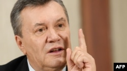 Former Ukrainian President Viktor Yanukovych talks during a press conference in Moscow in February.