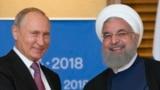 Президенты России и Ирана на саммите ШОС в китайском городе Циндао. 9 июня 2018 года