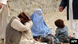 A family begs on the street in Kabul.