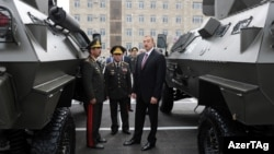 Azerbaijani President Ilham Aliyev, opening a military base in September, is up for reelection in October.