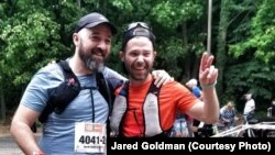 Jared with his friend after finishing ultra-marathon, 60 km run along the Berlin Wall