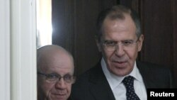 Russian Foreign Minister Sergei Lavrov (right) with his Algerian counterpart, Mourad Medelci, in Moscow on December 13