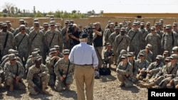 U.S. Defense Secretary Robert Gates speaks to the U.S. troops during a visit to Camp Victory in Baghdad on April 7.
