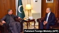 Pakistani Foreign Minister Shah Mahmood Qureshi meets with Zalmay Khalilzad, the U.S. Special Representative for Afghanistan Reconciliation, at the Foreign Ministry in Islamabad on April 5.