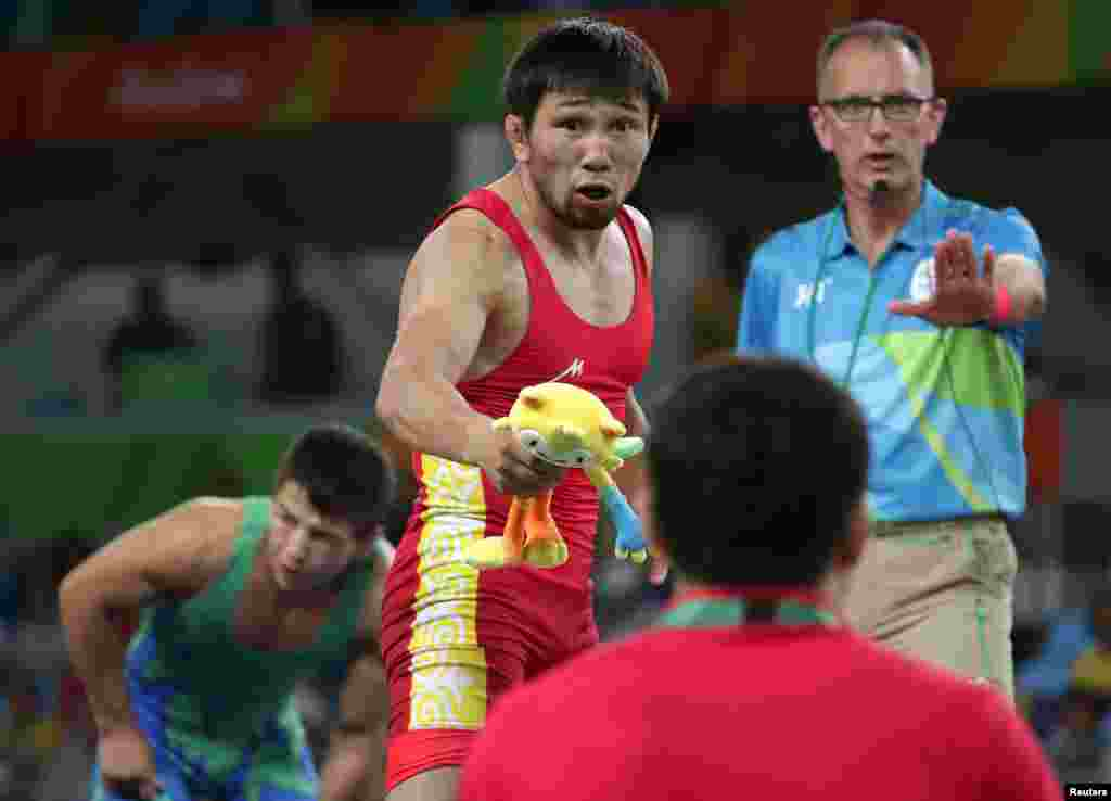 Arsen Eraliev of Kyrgyzstan reacts during the Greco-Roman wrestling competition.