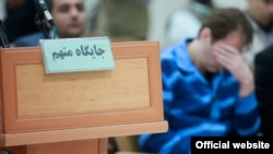 "Iranian tycoon, Babak Zanjani during a court hearing in his embezzlement trial. The sign in Persian says, ""The seat for the accused""."