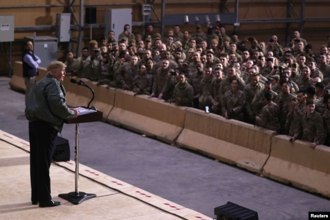 Trump speaks to U.S. troops in an unannounced visit to the Al-Asad Air Base in Iraq on December 26.