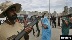 A paramilitary soldier stands guard after a gunfight in Karachi on June 2.