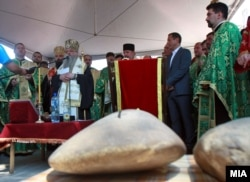 Prominent members of the Orthodox clergy preside over the laying of the cornerstone for the Holy Trinity church.