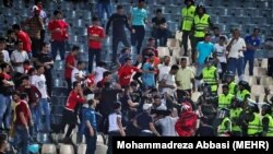 Clash between football fans and police forces in Soccer match between Esteghlal and Tractorsazi.