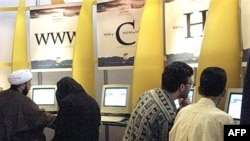 Iranians flock to Internet cafes in Tehran.