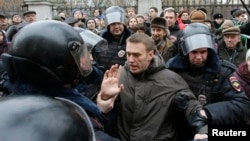 Russian police detain opposition leader Aleksei Navalny outside a courthouse in Moscow on February 24.