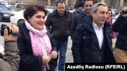 Azerbaijani investigative journalist Khadija Ismayilova (left) outside the Prosecutor General's Office in Baku in February with her lawyer Elton Guliyev. Ismayilova fears she will soon be detained as part of a crackdown on civil society in Azerbaijan.