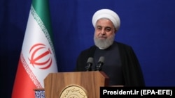 Iranian President Hassan Rouhani speaks during a ceremony in Tehran, May 23, 2019