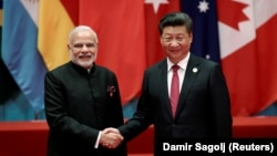 Chinese President Xi Jinping (right) shakes hands with Indian Prime Minister Narendra Modi during the G20 Summit in Hangzhou, Zhejiang Province, in September 2016.