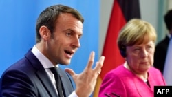 German Chancellor Angela Merkel and French President Emmanuel Macron (file photo)
