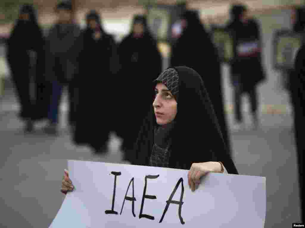 A student holds a placard as she attends a demonstration before a ceremony in Isfahan on November 15 to form a human chain around a uranium-conversion facility to show support for Iran's nuclear program. (REUTERS/Morteza Nikoubazl)