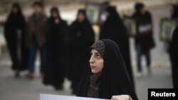 A student holds a placard as she attends a demonstration before a ceremony to form a human chain around an Iranian uranium-conversion facility in Isfahan to show support for the country's nuclear activities on November 15.