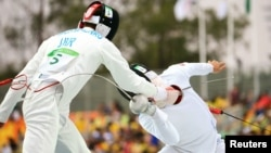 The Ukrainian team competing in the fencing event, part of the Modern Pentathlon, at the Rio Olympics in 2016.