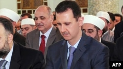 Syrian President Bashar al-Assad performs the morning Eid al-Fitr prayer at a mosque in Damascus in late August.