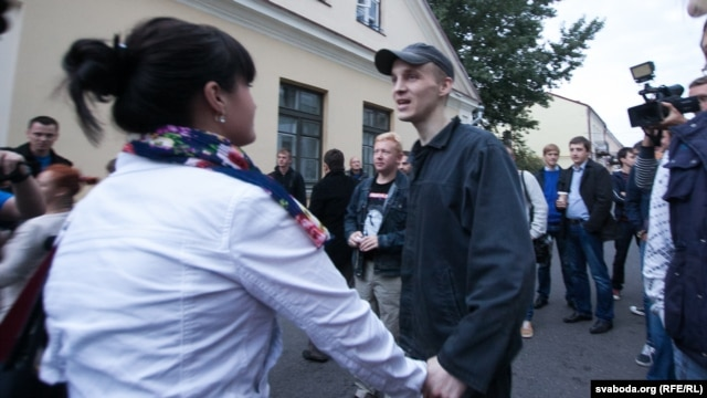 Opposition activist Zmitser Dashkevich greets relatives, including wife Nasta, and well-wishers on after his release from prison early on August 28.