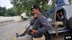 Pakistani security personnel guard the U.S. Consulate in Lahore this past week.